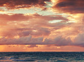 Colorful sunrise sky over Atlantic ocean. Toned photo filter — Stock Photo