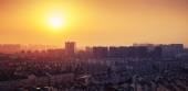 Bright colorful sunrise over big city panorama. Vintage toned — Stock Photo
