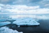 Winter coastal landscape with floating big ice fragments — Stock Photo