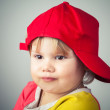 Studio portrait of funny girl in red baseball cap  — Stock Photo #63769743