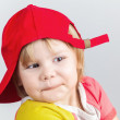 Funny smiling baby girl in red baseball cap — Stock Photo #63769747