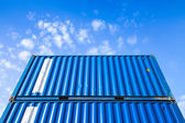 Blue steel Industrial cargo containers under cloudy sky — Stock Photo