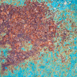 Old green grunge metal plate with big red rust spot — Stock Photo #65371147