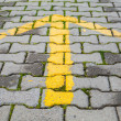 Yellow arrow painted on gray pavement, road direction sign — Stock Photo #65371261