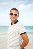 Outdoor portrait of young smiling Caucasian man — Stock Photo