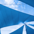 Awnings in sails shape over cloudy sky — Stock Photo #65927891