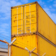 Yellow metal Industrial cargo containers are stacked — Stock Photo #65991287