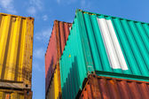 Colorful metal cargo containers under blue cloudy sky — Stock Photo