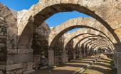Empty corridor with arcs and blue sky. Ruins of Smyrna — Stock Photo