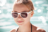 Little blond girl in sunglasses, closeup portrait — Stock Photo