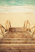 Empty wooden stairs goes down to the sea — Stock Photo