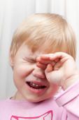 Portrait of blonde crying Caucasian baby girl — Stock Photo