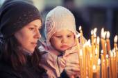 Mother and little blond Caucasian daughter in Church — Stock Photo