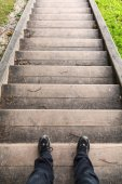 Male legs stand on old wooden stairs — Stock Photo