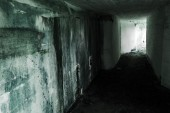 Empty abandoned bunker interior with glowing end — Stock Photo