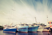Old ships and yachts are moored. Vintage toned photo — Stock Photo