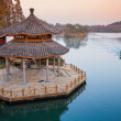 Small boat and Chinese wooden gazebo on the coast — Stock Photo #67076377
