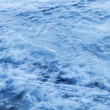 Blue melting ice surface on the frozen water — Stock Photo #67256947