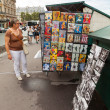Small art and souvenir shop with walking tourists in Paris — Stock Photo #67356813