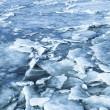 Big ice fragments covered with show on frozen river — Stock Photo #67505799