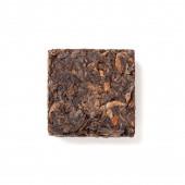 Small pressing briquette of black Chinese Shu Pu-erh tea  — Stock Photo