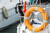 Modern yacht safety equipment, orange lifebuoy — Stockfoto
