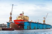 Floating blue dry dock with red tanker under repair — Stock Photo