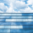 Blue mirrored glass and cloudy sky, office facade — Stock Photo #68590747