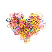 Small round colorful rubber bands in heart shape — Stock Photo