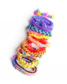 Group of colorful rubber band bracelets isolated on white — Stock Photo