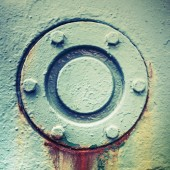 Cover mounted with bolts, abstract old industrial detail — ストック写真