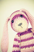 Funny knitted rabbit toy portrait, vintage toned — Stock Photo