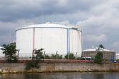 Big white oil tank on the sea coast in port — Stock Photo