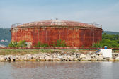 Large old rusted oil tank on the lake coast, Port of Varna — Stock Photo