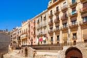 Colorful living houses facades and old ruined fortress — Stock Photo