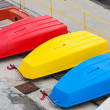 Colorful plastic boats lay on the pier, Black Sea coast — Stock Photo #69388127