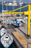 Yellow crane, sailing yachts and pleasure boats, Varna port — Stock Photo