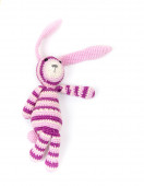 Funny knitted rabbit toy showing right direction  — Stock Photo