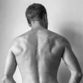 Back of Strong young Caucasian man, black and white — Stock Photo