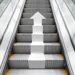 Shining metal escalator with white 3d arrow — Stock Photo #70004311