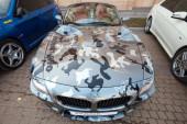 BMW z4 roadster car with gray camouflage color — Stok fotoğraf