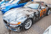 BMW z4 roadster car with camouflage color scheme — Stock Photo