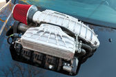 Supercharger, air compressor on a car hood — Stock Photo