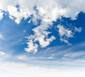 Bright blue cloudy sky background texture — Stock Photo