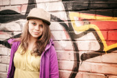 Blond stylish teenage girl stands near urban wal — Stock Photo