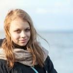 Closeup outdoor portrait of smiling beautiful blond Caucasian te — Stock Photo #71424605