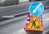 Roadsigns on the urban asphalt road — Stock Photo