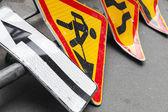 Roadsigns lay on asphalt road. Under construction — Stock Photo
