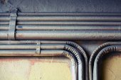 Group of bent vintage electrical conduits — Stock Photo