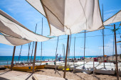 Awnings in sails shape covering relax area — Stock Photo